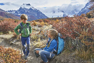 Argentina, Patagonia, El Chalten, two boys having a break from hiking in Los Glaciares National park - SSCF00307