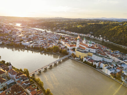 Germany, Bavaria, Passau, City of three rivers, Aerial view, Danube and Inn river at sunset - JUNF01564