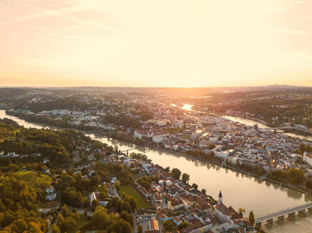 Germany, Bavaria, Passau, City of three rivers, Aerial view, Danube and Inn river at sunset - JUNF01567