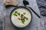 Creme of mushroom soup with cocosnut milk, parsley and baguette - SARF04011