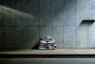 Stack of old abandoned newspapers - INGF08995