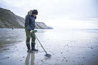 Man with metal detector at the sand beach - REAF00503