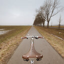 Bicycle parked on a country road - INGF09175