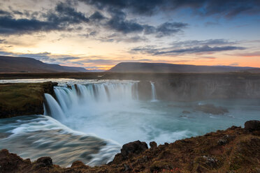 Scenic nature view of a waterfall at sunset - INGF09319
