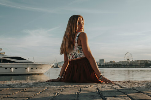 A young woman posing by a boat - INGF09340