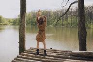 A woman posing by a lake - INGF09349