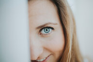 Close-up portrait of woman with blue eyes - INGF09373