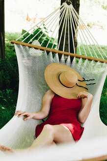 A woman relaxing on a hammock - INGF09394