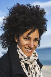 Portrait of smiling woman with curly hair - AFVF02066