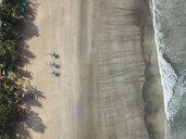 Bali, Kuta Beach, three beach umbrellas, aerial view - KNTF02501