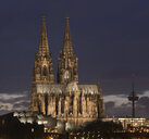 Germany, Cologne, lighted Museum Ludwig, Cologne Cathedral and television tower at dusk - SKAF00070