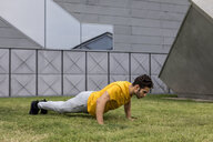 Young man during workout, pushup - MAUF01874