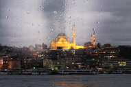 View of the mosque with evening lights through a rainy window - INGF09861