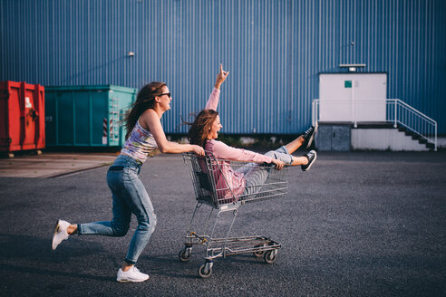 Two young women having fun outdoors - INGF09905