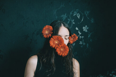 A woman with red flowers over her face - INGF09977