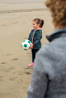 A young girl playing with a ball on the beach - INGF10076