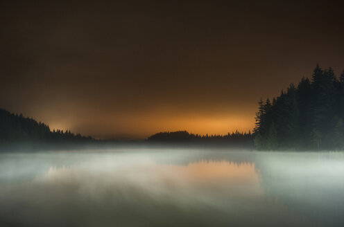 Long exposure of fog over lake at Mt Hood National Forest against sky during sunset - CAVF59851