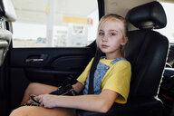 Portrait of girl sitting in car - CAVF59950