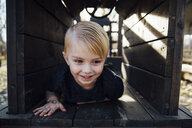 Close-up of smiling boy playing at park - CAVF59953