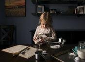 Girl preparing food on table at home - CAVF60276