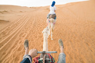 Friends riding on camels at Merzouga desert - CAVF60502