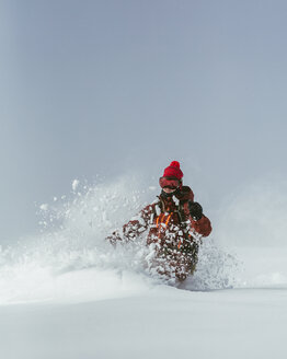 Hiker skiing on ski slope against sky during winter - CAVF60601