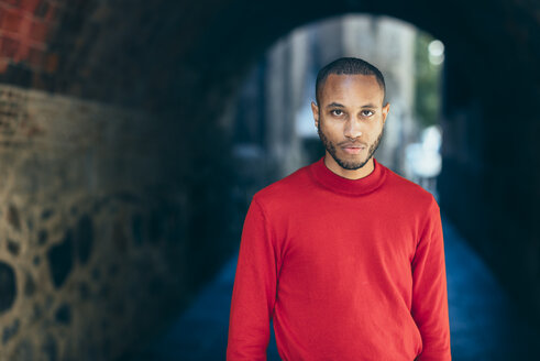 Portrait of young man in an underpass wearing red pullover - JSMF00702
