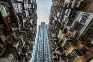 Hong Kong, Quarry Bay, apartment blocks contrasting with modern skyscraper - DAWF00806