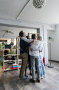 Business team huddling in loft office - GIOF05146