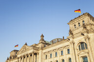 Germany, Berlin, Reichstag building and German flags - GWF05708