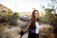 USA, California, Los Angeles, portrait of smiling woman in Joshua Tree National Park - DAWF00849