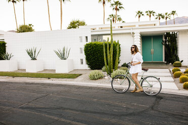 USA, California, Palm Springs, woman on bicycle on the street - DAWF00864