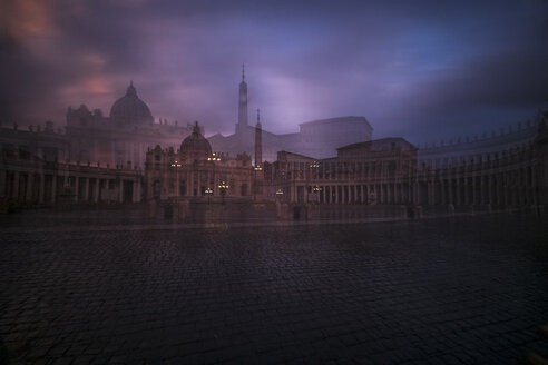Italy, Rome, View of St. Peter's Basilica and St. peter's square at Vatican fog in the evening - HAMF00537