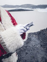 Santa Claus with mobile phone at North Pole - OCMF00183