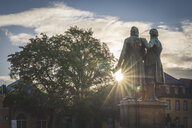 Germany, Weimar, bach view of Goethe-Schiller Monument at sunrise - KEBF01024
