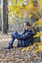 Portrait of unhappy girl in autumnal forest - BFRF01940