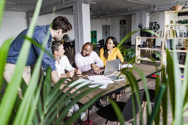 Confident business team having a meeting in loft office - GIOF05194