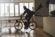 Man entering office with his bicycle - RIBF00819
