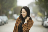Smiling woman standing outdoors - HEROF00129