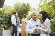 Couple with drinks at outdoor party - HEROF00297