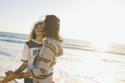Couple dancing on beach - HEROF00348