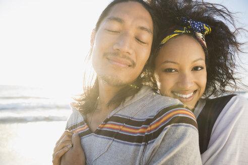 Affectionate couple on beach - HEROF00375