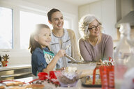 Three generation family baking cookies at Christmas - HEROF00465