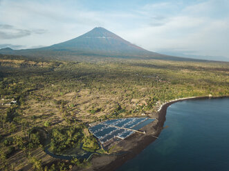 Indonesia, Bali, Amed, Aerial view of shrimp farm and volcano Agung in background - KNTF02558