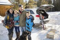 Portrait of happy family on ski holiday - HEROF00603