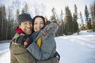 Portrait of affectionate couple in winter - HEROF00813