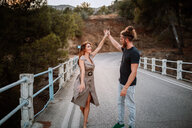 A cool young couple dancing outdoors - INGF10437