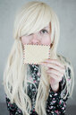Portrait of a beautiful blonde woman holding an envelope - INGF10512