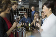 Sommelier and couples wine tasting in store - HEROF01321