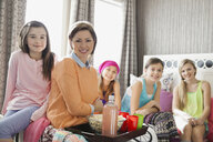 Portrait of smiling mother with girls at slumber party - HEROF01390